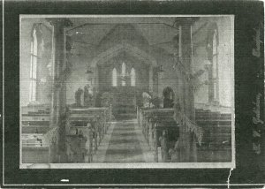 The only surviving photo of the original Trinity Church, built in 1851 and burned in 1900.