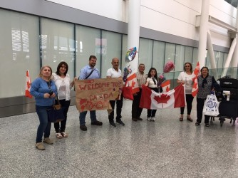 """A Canadian welcome! Our Bill White holding the """"Welcome to Canada"""" sign."""